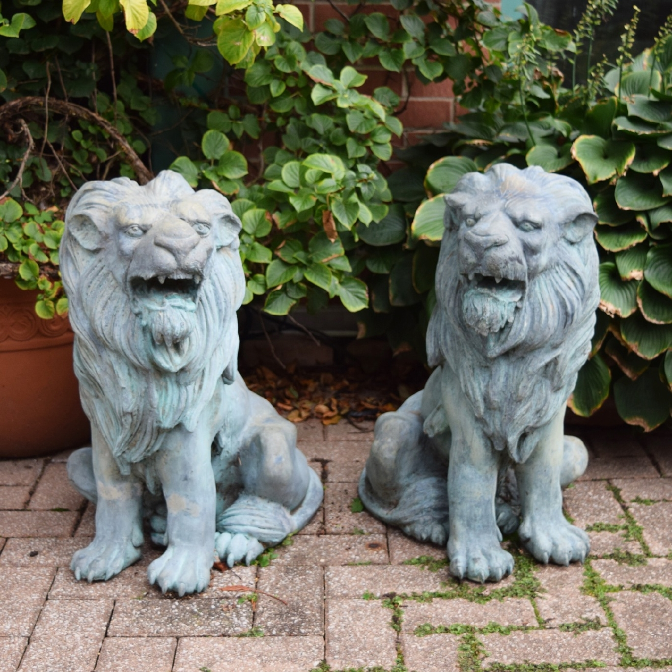 Pair of Outdoor Seated Lions in Copper and Zinc / Image courtesy of Everything But The House // Published: 10.15.16
