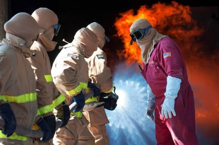 Firefighting instructors give directions to sailors during general shipboard firefighting training on Naval Base San Diego. Training consists of classrooms, hands-on training to teach hose handling, shipboard firefighting and using firefighting equipment.