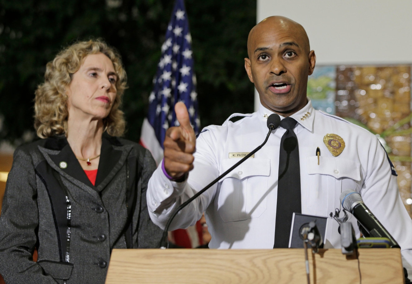 Charlotte-Mecklenburg Police chief Police Chief Kerr Putney, right, gestures as he answers a question as Charlotte mayor Jennifer Roberts, left, watches during a news conference after a second night of violence following Tuesday's fatal police shooting of Keith Lamont Scott in Charlotte, N.C. Thursday, Sept. 22, 2016. (AP Photo/Chuck Burton)