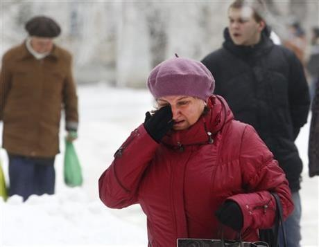 A Volgograd resident walks crying in Volgograd, Russia early Monday, Dec. 30, 2013. A bomb blast tore through a trolleybus in the city of Volgograd on Monday morning, killing at least 10 people.