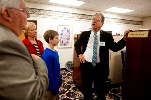 In this March 24, 2015, photo, State Rep. Mike Braun, R-Jasper, right, shows Marvin and Vicky Eisenhut, of Haysville, Ind., and their grandson Cooper Uebelhor of Ferdinand, 12, his office at the Indiana Statehouse in Indianapolis. (The Herald via AP)<p></p>