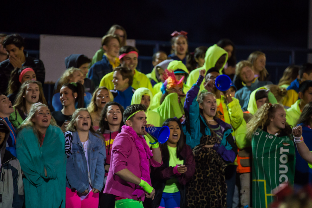Churchill's student section showed up in neon clothing to cheer on their team. The Churchill Lancers defeated the Springfield Millers 56-7 in a cold game Friday night. Friday night's win extended Churchill's season to 7-0. Photo by Dillon Vibes