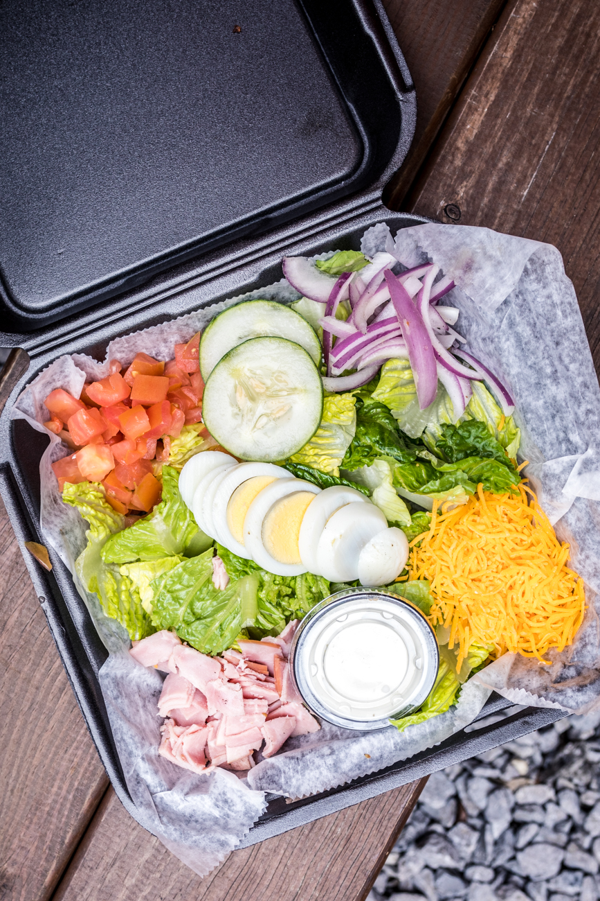 Chef salad: sliced ham, tomato, red onion, cucumber, cheddar cheese, and a hard boiled egg atop a bed of romaine / Image: Catherine Viox // Published: 4.6.20