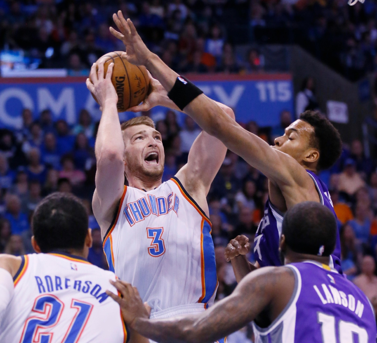 Oklahoma City Thunder forward Domantas Sabonis (3) is fouled by Sacramento Kings forward Skal Labissiere, right, in the first quarter of an NBA basketball game in Oklahoma City, Saturday, March 18, 2017. (AP Photo/Sue Ogrocki)