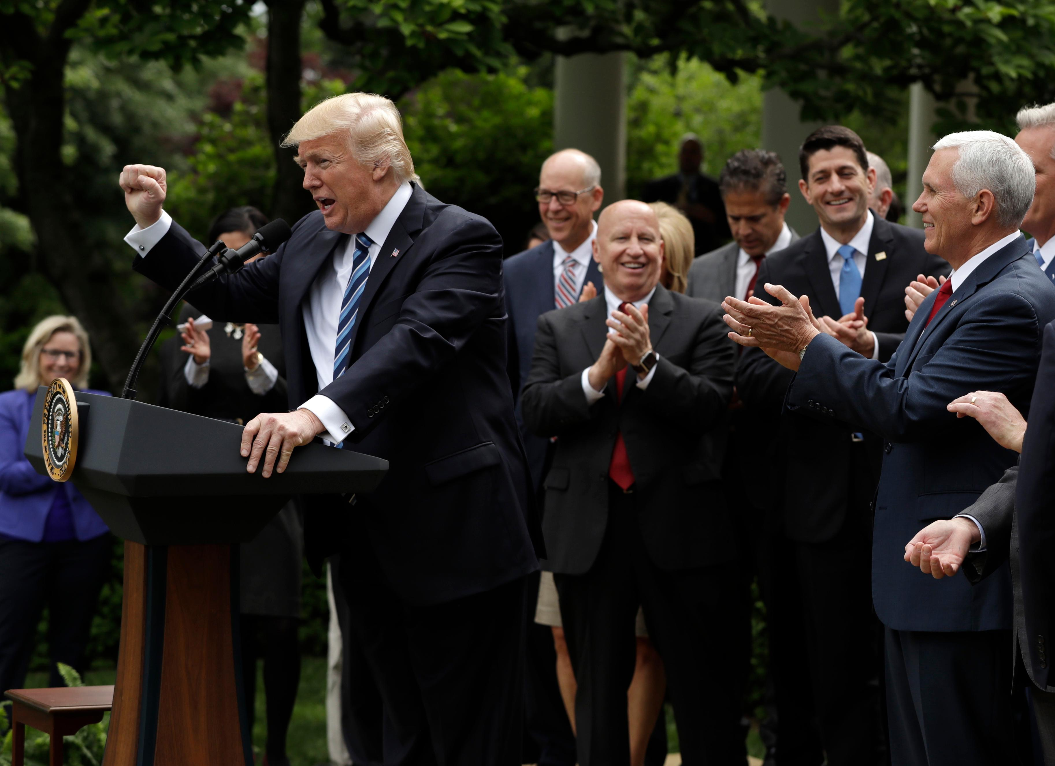trump house gop celebrate passage of health care bill with a