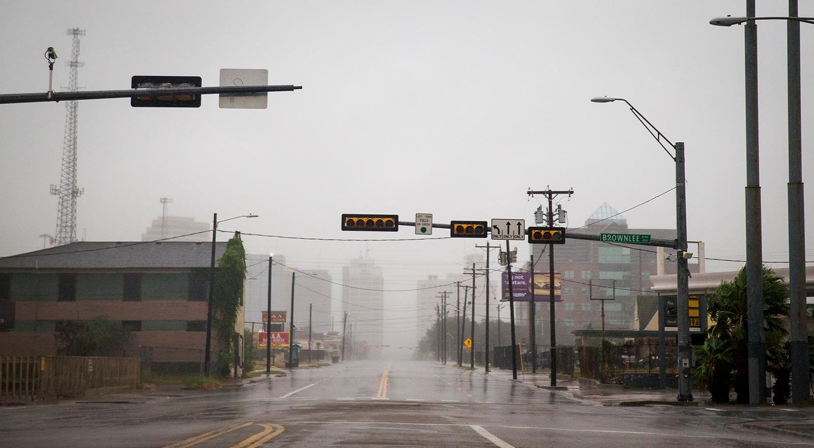 A street sits empty as Hurricane Harvey makes landfall in Corpus Christi, Texas, on Friday, Aug. 25, 2017. Hurricane Harvey smashed into Texas late Friday, lashing a wide swath of the Gulf Coast with strong winds and torrential rain from the fiercest hurricane to hit the U.S. in more than a decade.  (Nick Wagner/Austin American-Statesman via AP)