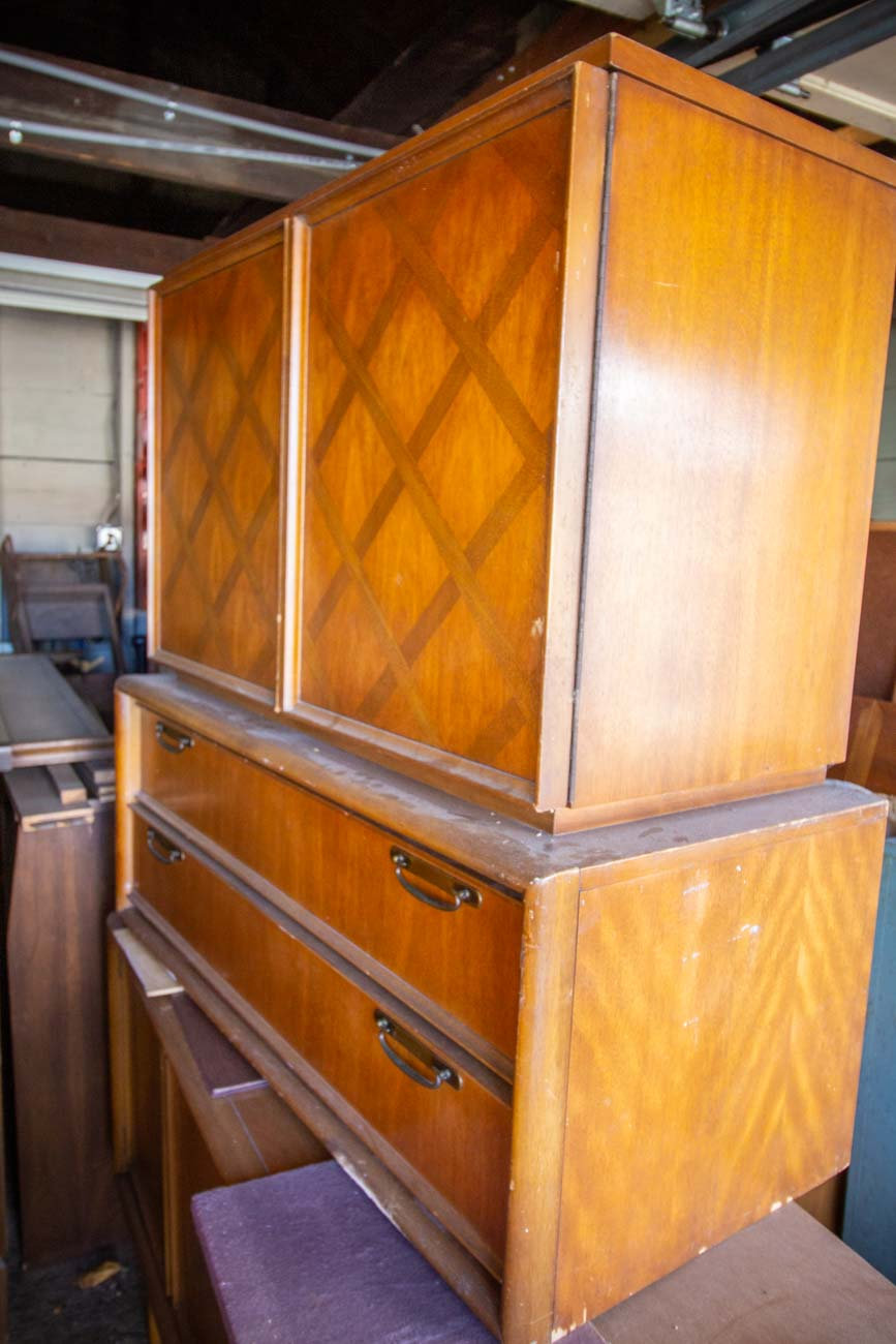"Jeff discovers most of his unique and interesting finds online. He doesn't repurpose them so much as he works to get them back to their original quality or close to it. At most, he'll strip paint and give a piece a natural stain to repair a color, or replace knobs, legs, or other parts if needed. ""It's a lot of refinishing,"" Jeff says. ""The nice thing about these pieces of furniture is they're made so well… For the most part, they're all intact and constructionally sound."" / Image: Katie Robinson, Cincinnati Refined // Published: 12.14.20"