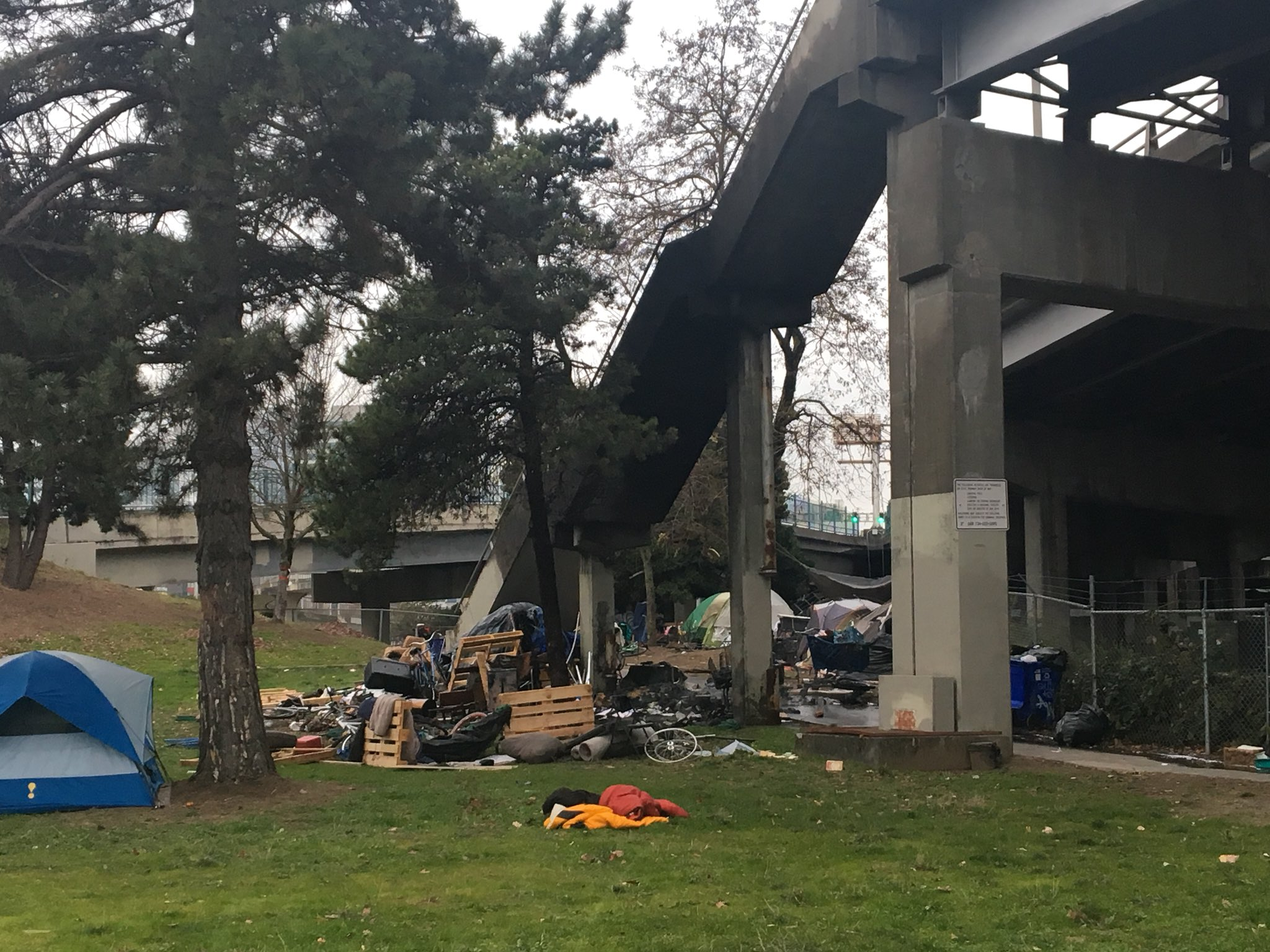 Crews responded to tents on fire at a homeless camp on the east side of the Morrison Bridge on Dec. 15, 2017. KATU photo