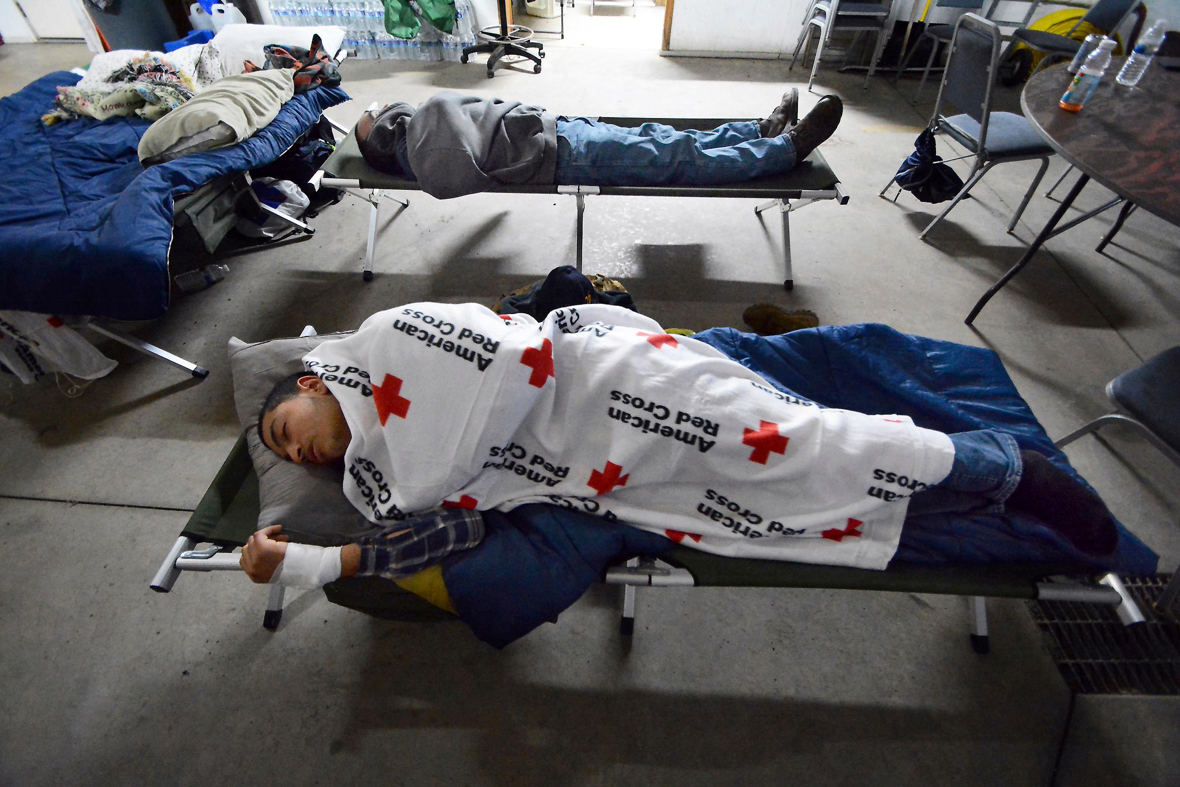 Residents sleep inside the Dingman Township Volunteer Fire Department in Dingman Township, Pa., on Wednesday, March 7, 2018, during the second snow storm that hit the region in Northeastern Pennsylvania in less then a week. The fire department has been used as a make-shift shelter for area residents who have no power or water in their homes. Its been running as a shelter since last Friday. ( Butch Comegys / The Scranton Times-Tribune via AP)