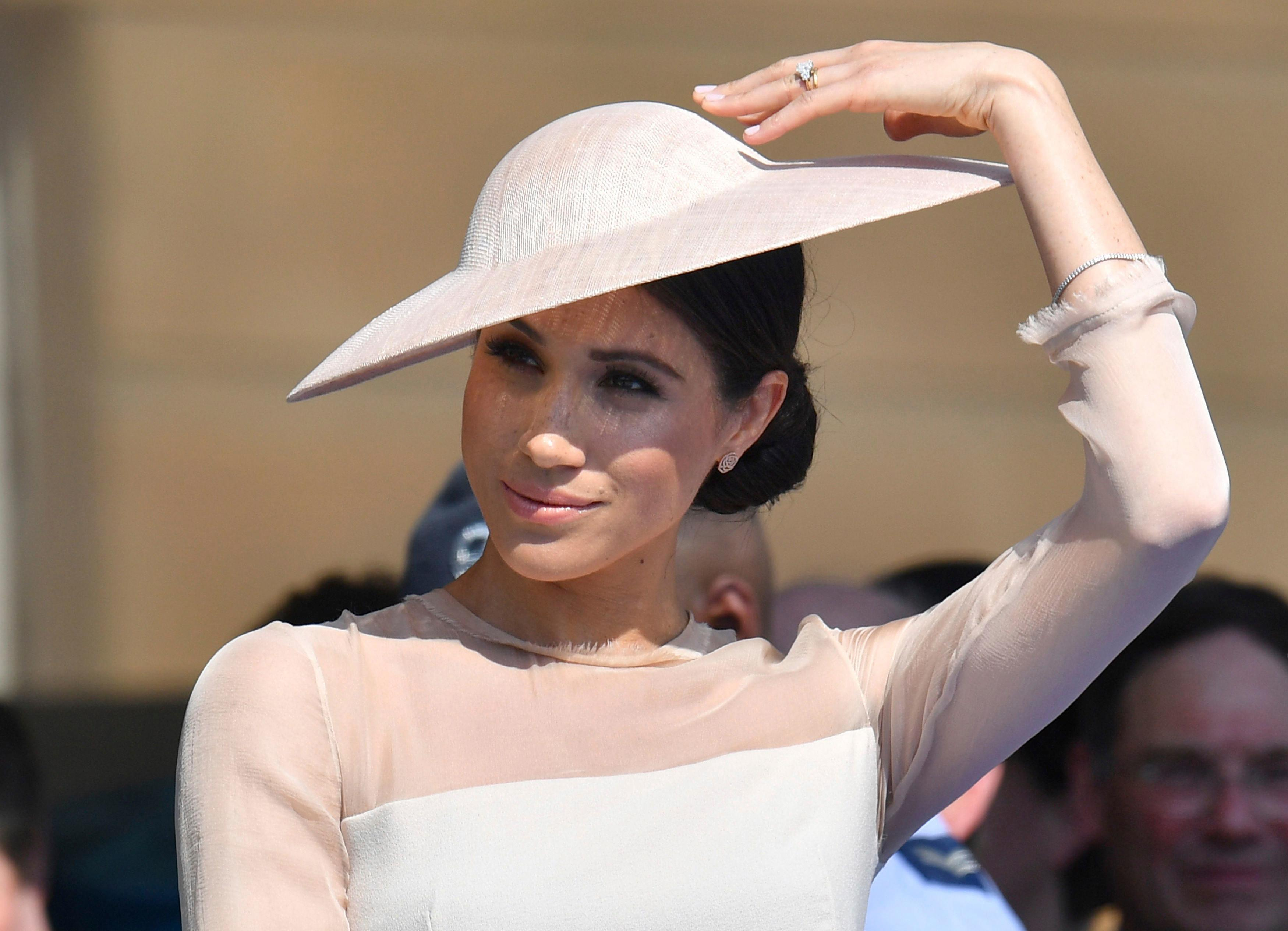 Meghan, the Duchess of Sussex gestures as she attends a garden party at Buckingham Palace in London, Tuesday, May 22, 2018, her first royal engagement a since her wedding to Prince Harry on Saturday. The event is part of the celebrations to mark the 70th birthday of Prince Charles. (Dominic Lipinski/Pool Photo via AP)