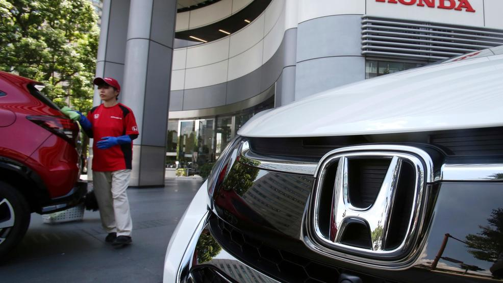 In This File Photo, An Employee Of Honda Motor Co. Cleans A Honda Car  Displayed At Its Headquarters In Tokyo. Japanese Automaker Honda Motor Co.  Is ...