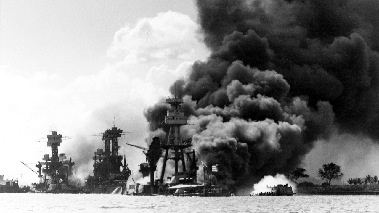 Black smoke rising from Battleship Row adjacent during the Japanese attack on Pearl Harbor. (U.S. Navy National Museum of Naval Aviation/MGN)