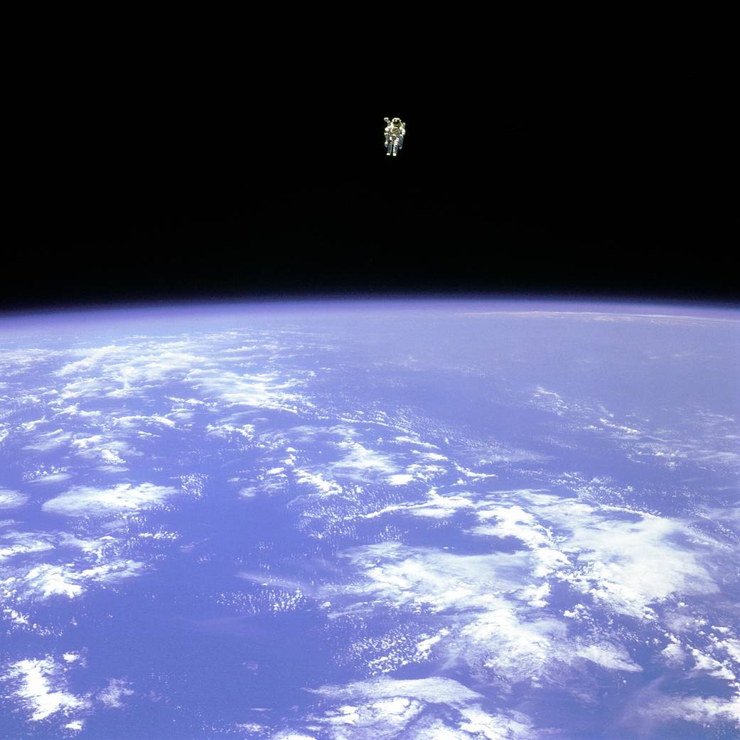 <p>On Feb. 12, 1984, astronaut Bruce McCandless, ventured further away from the confines and safety of his ship than any previous astronaut had ever been. This space first was made possible by a nitrogen jet propelled backpack, previously known at NASA as the Manned Maneuvering Unit or MMU.After a series of test maneuvers inside and above Challenger's payload bay, McCandless went &quot;free-flying&quot; to a distance of 320 feet away from the Orbiter. This stunning orbital panorama view shows McCandless out there amongst the black and blue of Earth and space. (Image Credit: NASA)</p>
