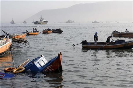 Fishing boats lie damaged by a small tsunami, in the northern town of Iquique, Chile, after magnitude 8.2 earthqauke struck the northen coast of Chile, Wednesday, April 2, 2014.