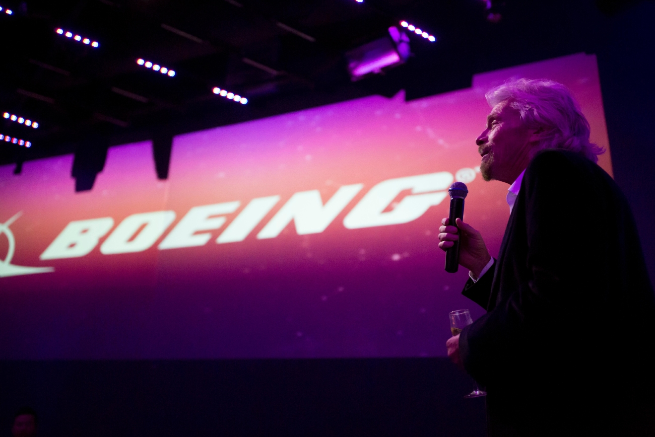 Sir Richard Branson greets the guests at the #HelloSeattle Virgin Atlantic party at Q Nightclub, celebrating the airline's new route from London to Seattle. (Sy Bean / Seattle Refined)