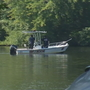 Police: Men apparently drowned after saving woman