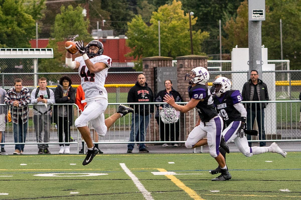 North Medford Elias Spence (#44) attempts a reception. North Medford defeated South Eugene 27 – 8 on Monday afternoon at South Eugene High School. The game had been rescheduled due to unhealthy levels of smoke in the air caused by nearby forest fires. Photo by Kit MacAvoy, Oregon News Lab