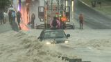 DRAMATIC VIDEO: Firefighters pull off daring rescue as SUV bobs in raging floodwaters