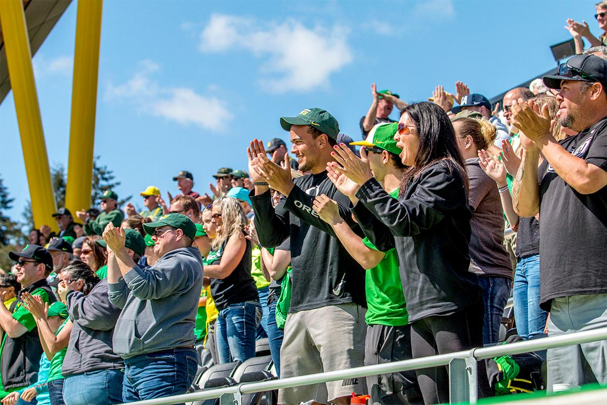 The crowd cheers on the Ducks upon their game winning point. The Oregon Ducks Softball team took their third win over the Arizona Sun Devils, 1-0, in the final game of the weekends series that saw the game go into an eighth inning before the Duck?s Mia Camuso (#7) scored a hit allowing teammate Haley Cruse (#26) to run into home plate for a point. The Ducks are now 33-0 this season and will next play a double header against Portland State on Tuesday, April 4 at Jane Sanders Stadium. Photo by August Frank, Oregon News Lab