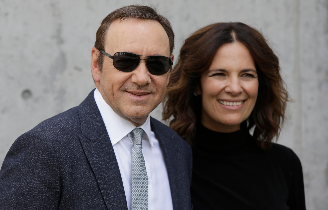Actor Kevin Spacey is flanked by Roberta Armani upon his arrival to attend the Giorgio Armani men's Spring-Summer 2016-2017 fashion show, that was presented in Milan, Italy, Tuesday, June 21, 2016. (AP Photo/Luca Bruno)