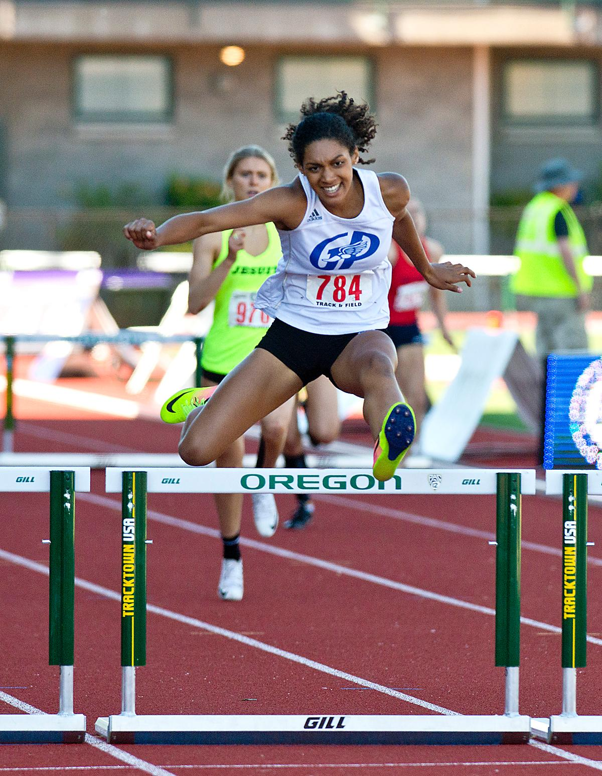 Deshae Wise from Grants Pass wins the 6A Girls 300 Low Hurdles with a time of 42.86 at the OSAA Championship at Hayward Field on Saturday. Photo by Dan Morrison, Oregon News Lab