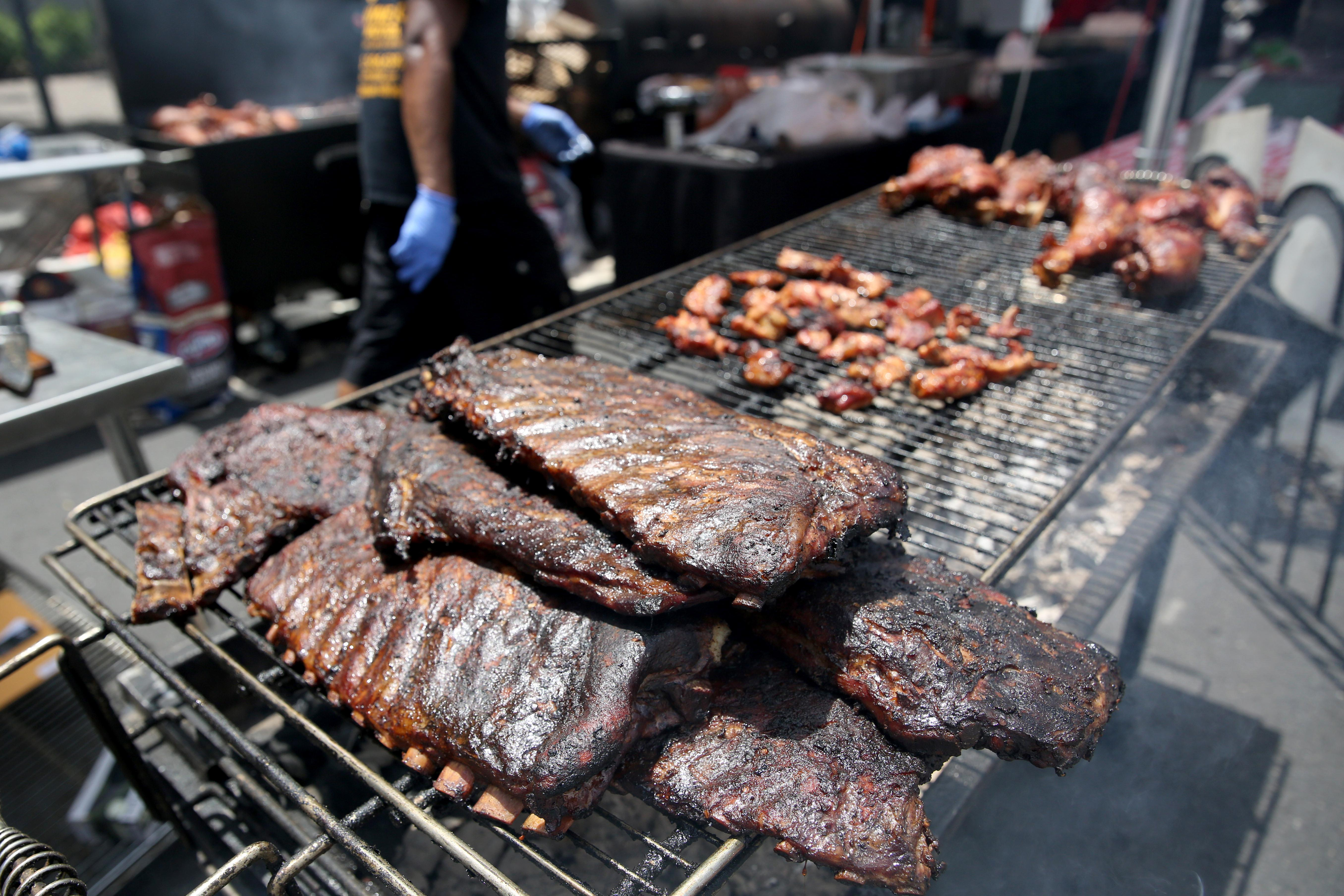The smell of barbecue wafted over D.C. this weekend during the the 25th annual Capital Barbecue Battle. The two-day festival let visitors try out new food while pit masters battled it out to win prizes. (Amanda Andrade-Rhoades/DC Refined)