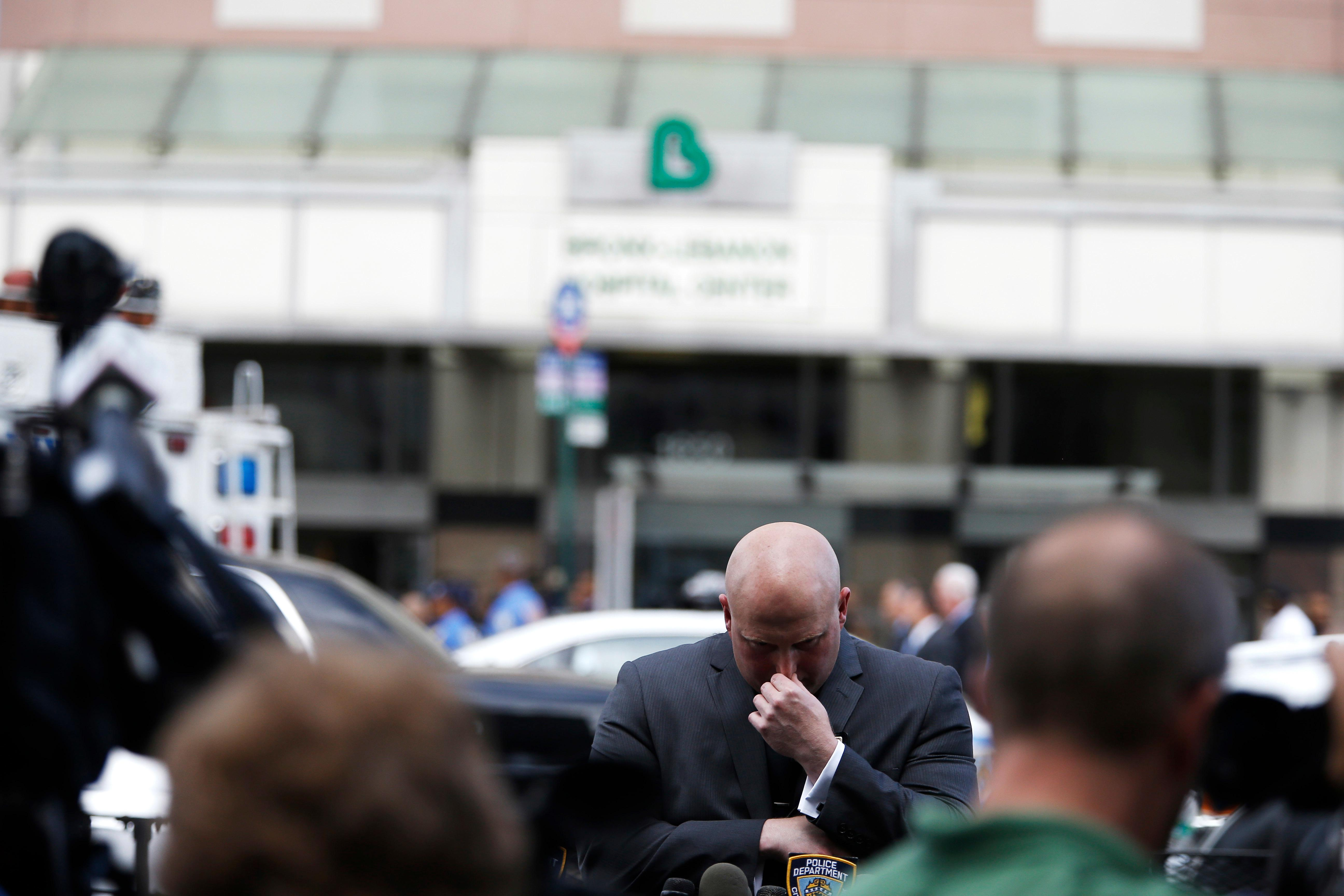 NYPD Spokesperson Mike Debonis before a press conference at the scene of shooting killing one and wounding six others at Bronx Lebanon Hospital Center Friday, June 30, 2017, in New York. (AP Photo/Michael Noble)