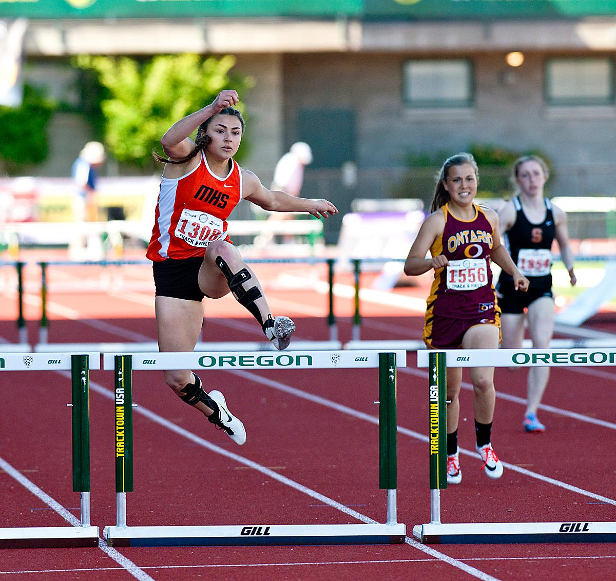 Desirae DesRosiers from Molalla wins the 4A Girls 300 Low Hurdles with a time of 45.70 at the OSAA Championship at Hayward Field on Saturday. Photo by Dan Morrison, Oregon News Lab