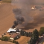 Firefighters work to put out a barn fire in rural Washington County
