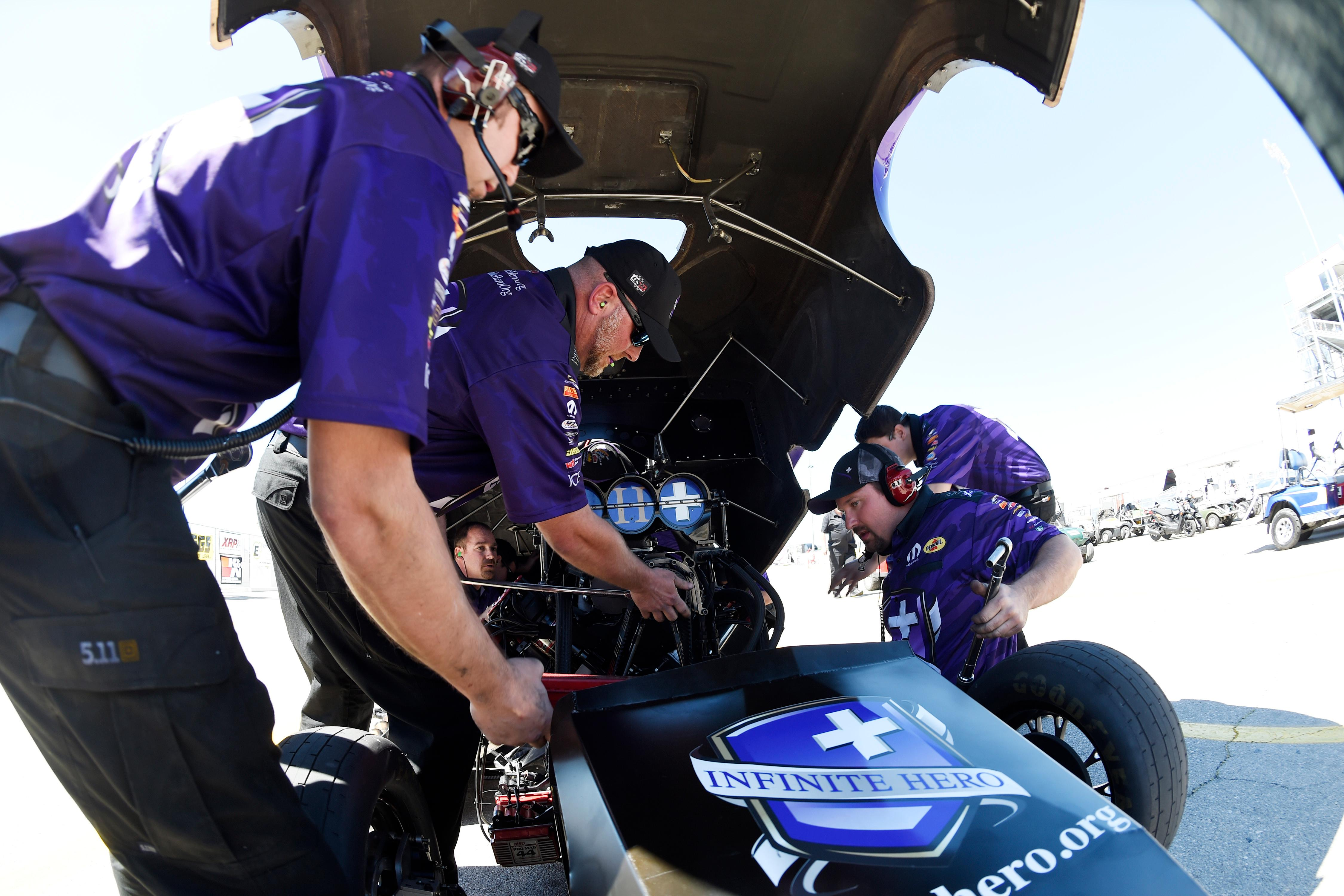 Funny Car driver Jack Beckman's crew members make final adjustments to their car during the NHRA DENSO Spark Plug Nationals at The Strip at the Las Vegas Motor Speedway Sunday, April 2, 2017. (Sam Morris/Las Vegas News Bureau)