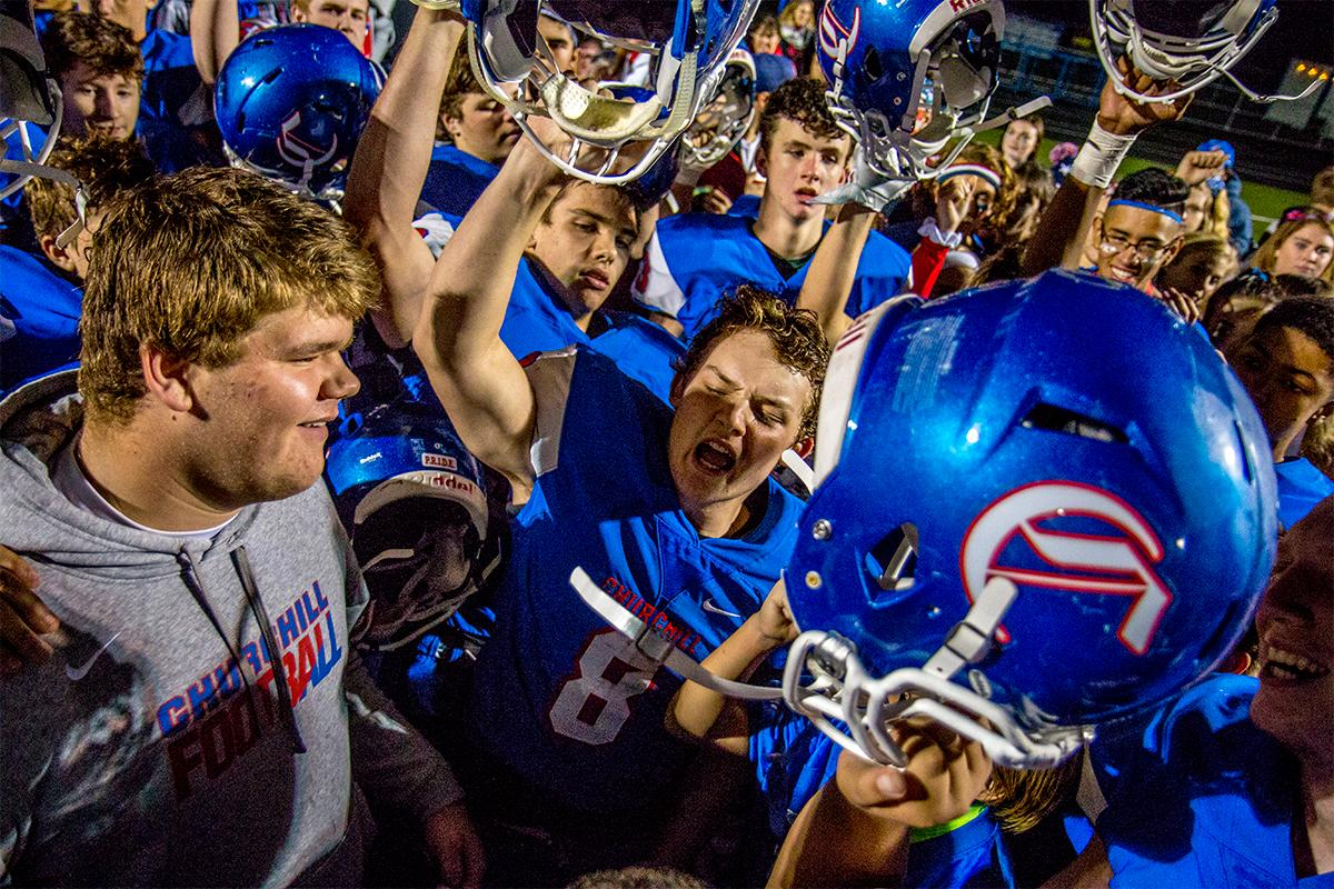 The Churchill Lancers celebrate their win in their post team talk. Churchill defeated Crater 63-21 on Friday at their homecoming game. Churchill remains undefeated with a conference record of 9-0. Photo by August Frank, Oregon News Lab