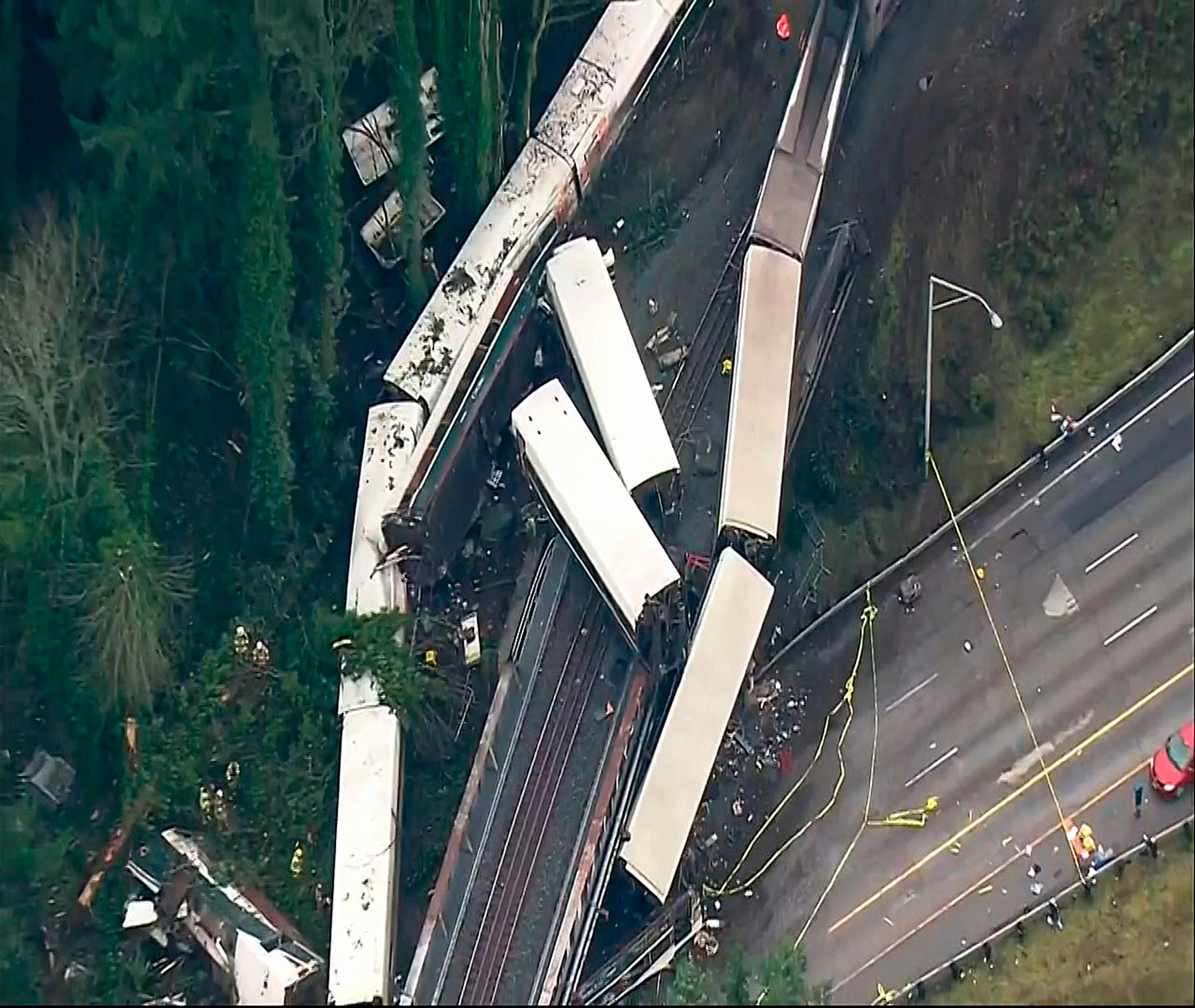 "This image from video provided by KOMO-TV, shows the site of an Amtrak train that derailed south of Seattle on Monday, Dec. 18, 2017. Authorities reported ""injuries and casualties."" The train derailed about 40 miles (64 kilometers) south of Seattle before 8 a.m., spilling at least one train car on to busy Interstate 5. (KOMO-TV via AP) TV OUT MANDATORY CREDIT"