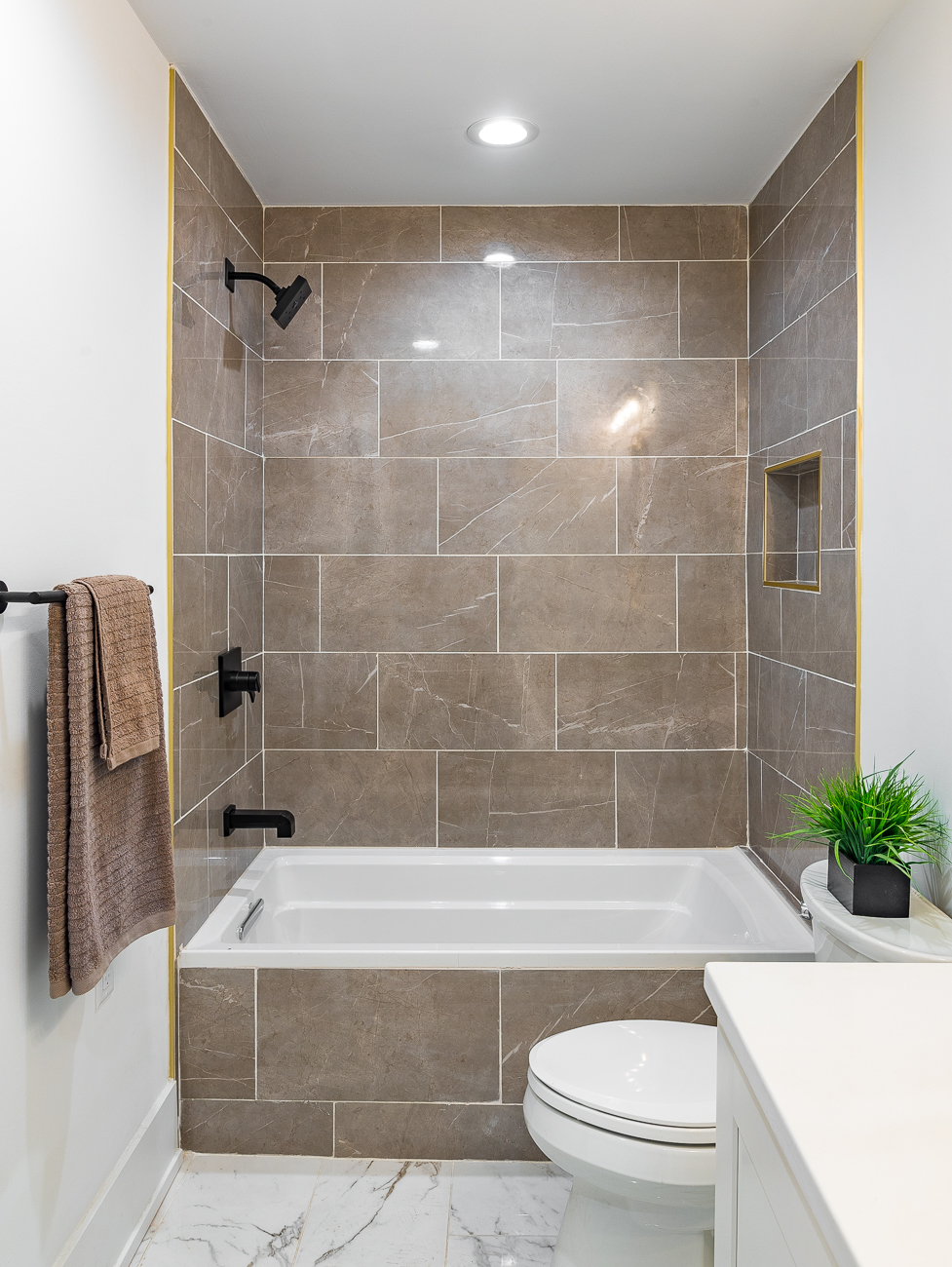 A bathroom with a tub is on the first floor. / Image: Phil Armstrong, Cincinnati Refined // Published: 2.4.19
