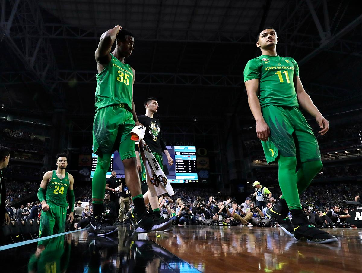 Oregon's Kavell Bigby-Williams (35) and Keith Smith (11) walk off the court after a semifinal against North Carolina in the Final Four NCAA college basketball tournament, Saturday, April 1, 2017, in Glendale, Ariz. North Carolina won 77-76. (AP Photo/David J. Phillip)