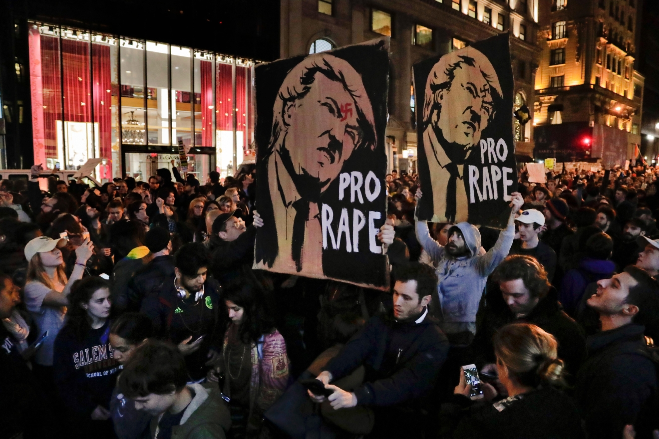 Protesters march along Fifth Avenue outside Trump Tower, Wednesday, Nov. 9, 2016, in New York, in opposition of Donald Trump's presidential election victory. (AP Photo/Julie Jacobson)