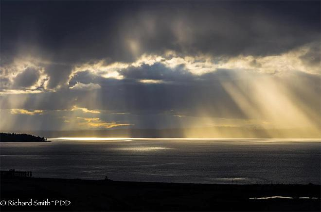 Crepuscular Rays over Chambers Bay (Photo Courtesy: Richard Smith)