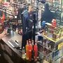 GRAPHIC VIDEO: Liquor store clerks shoot armed robbery suspect, fight over gun
