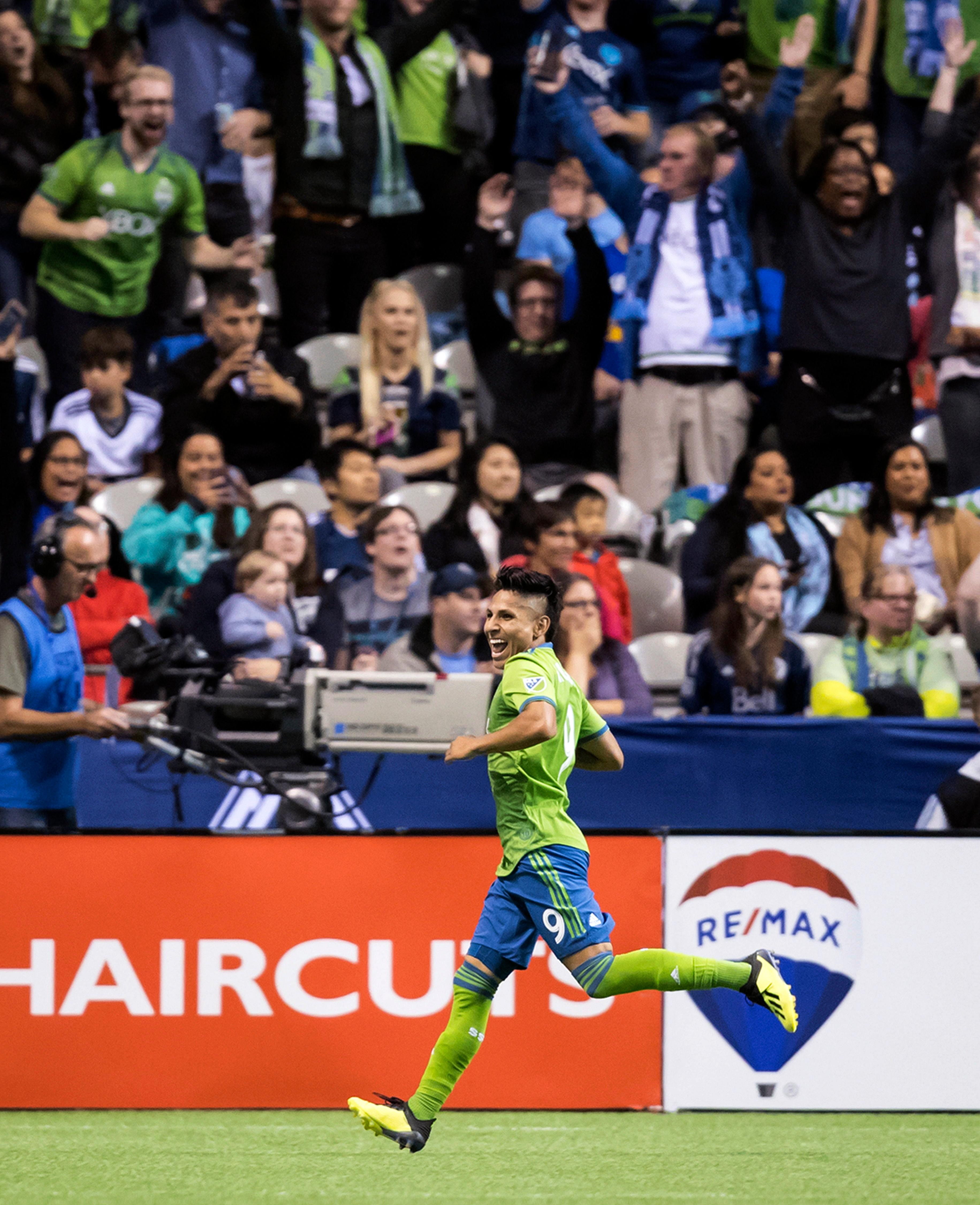 Seattle Sounders' Raul Ruidiaz celebrates his second goal against the Vancouver Whitecaps during the first half of an MLS soccer match, Saturday, Sept. 15, 2018, in Vancouver, British Columbia. (Darryl Dyck/The Canadian Press via AP)