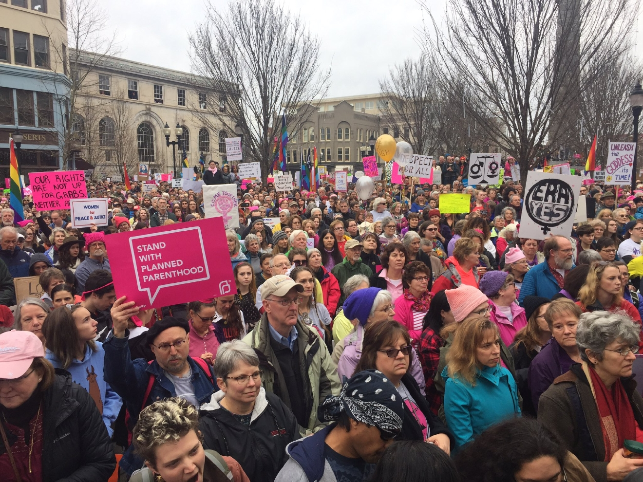 Thousands of people showed up for the rally and march on Saturday, wearing pink knit hats and carrying signs. Asheville police estimated the crowd at six to seven thousand participants. Police acknowledged that was just an estimate. Organizers said the crowd was closer to 10,000. (Photo credit: WLOS staff)