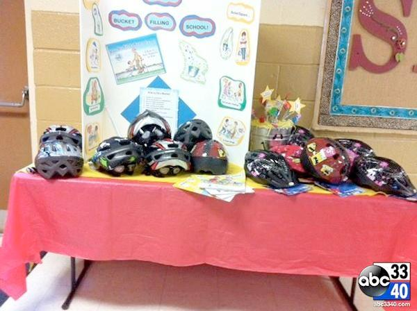 A collection of bike helmets at Cordova Elementary School on Thursday, February 20, 2014. The helmets will be used by students during severe weather.