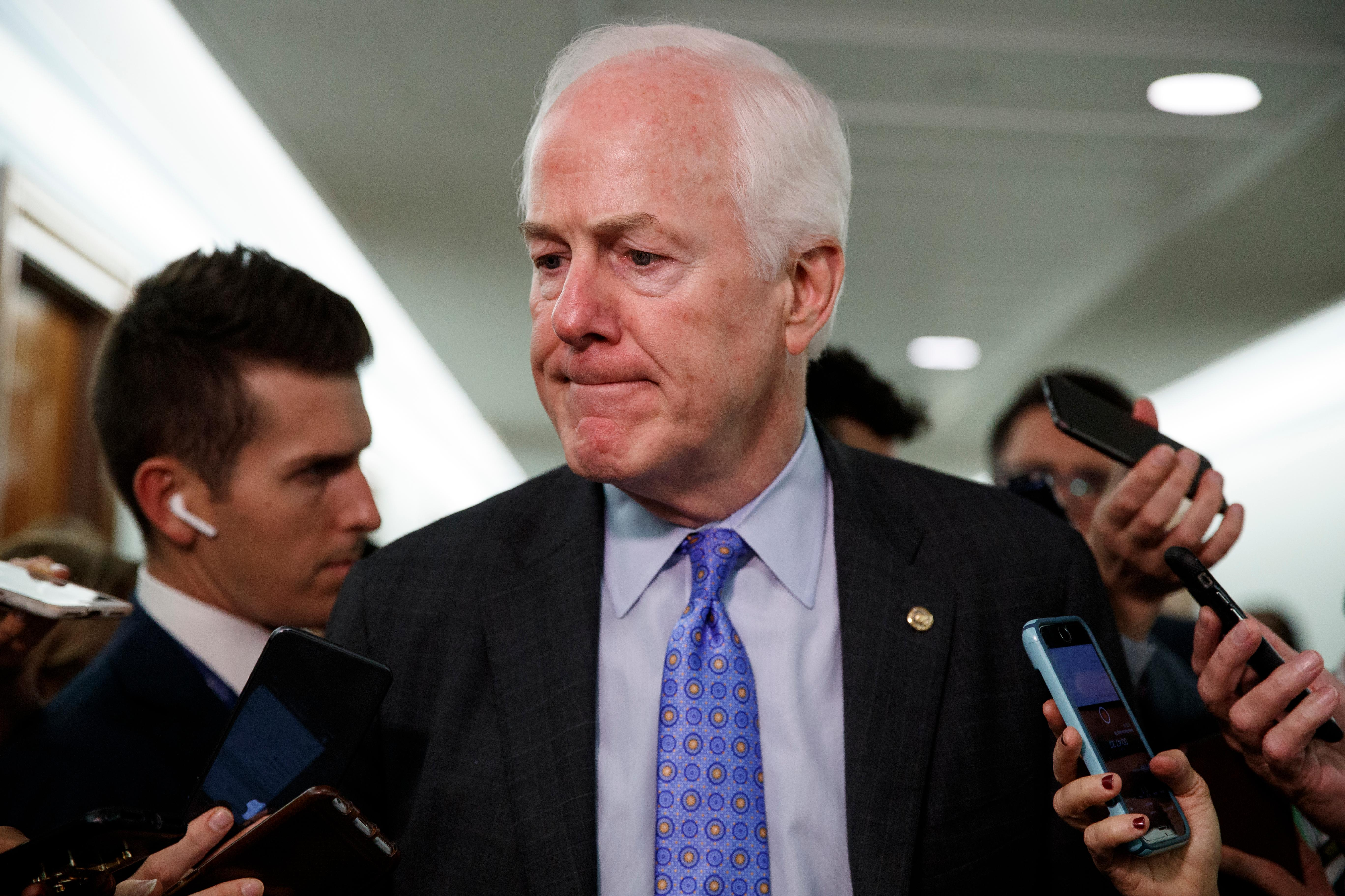 Sen. John Cornyn, R-Texas leaves the Senate Judiciary Committee hearing on Thursday, Sept. 27, 2018, with Christine Blasey Ford and Supreme Court nominee Brett Kavanaugh. (AP Photo/Carolyn Kaster)