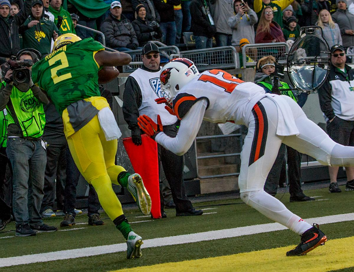 Oregon Ducks Bralon Addison (#2) receives a touchdown pass as Oregon State Beavers Kendall Hill (#12) pushes him out of the endzone. The Oregon Ducks beat the Oregon State Beavers 52-42 in the 119th Civil War for the eighth year in a row at Autzen Stadium on Friday afternoon. Katie Pietzold, Oregon News Lab
