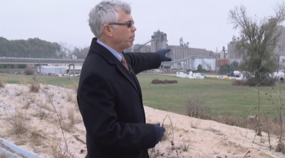 President of the Upper Mississippi, Illinois, and Missouri Rivers Association Michael Klingner stands atop the South Quincy Levee. He is looking back at the more than $500 million dollars of economic growth since the levee was built up to its 500 flood level status.<p></p>