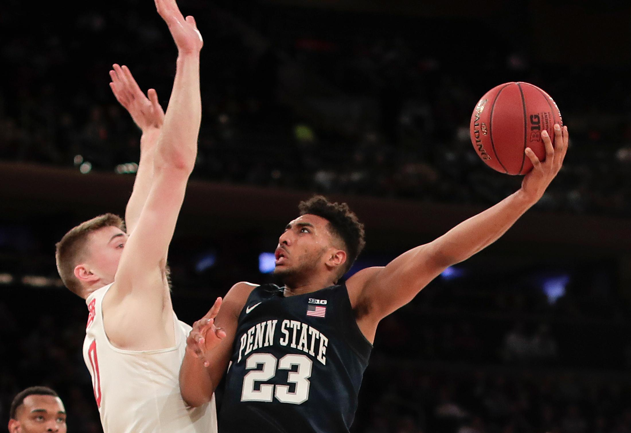 Penn State guard Josh Reaves (23) puts up a shot against Ohio State center Micah Potter (0) during the second half of an NCAA Big Ten Conference tournament college basketball game, Friday, March 2, 2018, in New York. Penn State won 69-68. (AP Photo/Julie Jacobson)