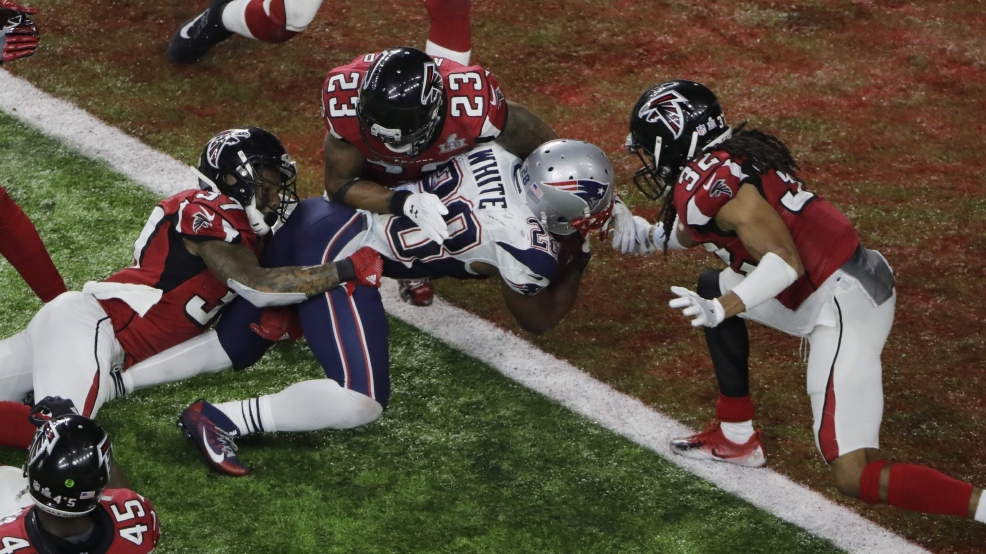 The New England Patriots' James White scores the winning touchdown during overtime of Super Bowl 51 against the Atlanta Falcons, Sunday, Feb. 5, 2017, in Houston. THE ASSOCIATED PRESS