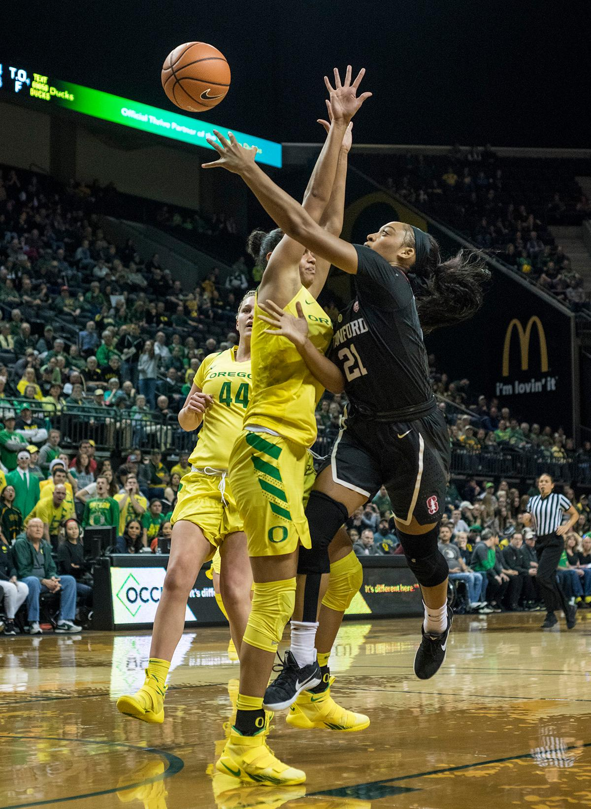 Stanford Cardinal DiJonai Carrington (#21) aims for the basket as Oregon Ducks Satou Sabally (#0) attempts to block the shot. The Stanford Cardinal defeated the Oregon Ducks 78-65 on Sunday afternoon at Matthew Knight Arena. Stanford is now 10-2 in conference play and with this loss the Ducks drop to 10-2. Leading the Stanford Cardinal was Brittany McPhee with 33 points, Alanna Smith with 14 points, and Kiana Williams with 14 points. For the Ducks Sabrina Ionescu led with 22 points, Ruthy Hebard added 16 points, and Satou Sabally put in 14 points. Photo by Rhianna Gelhart, Oregon News Lab