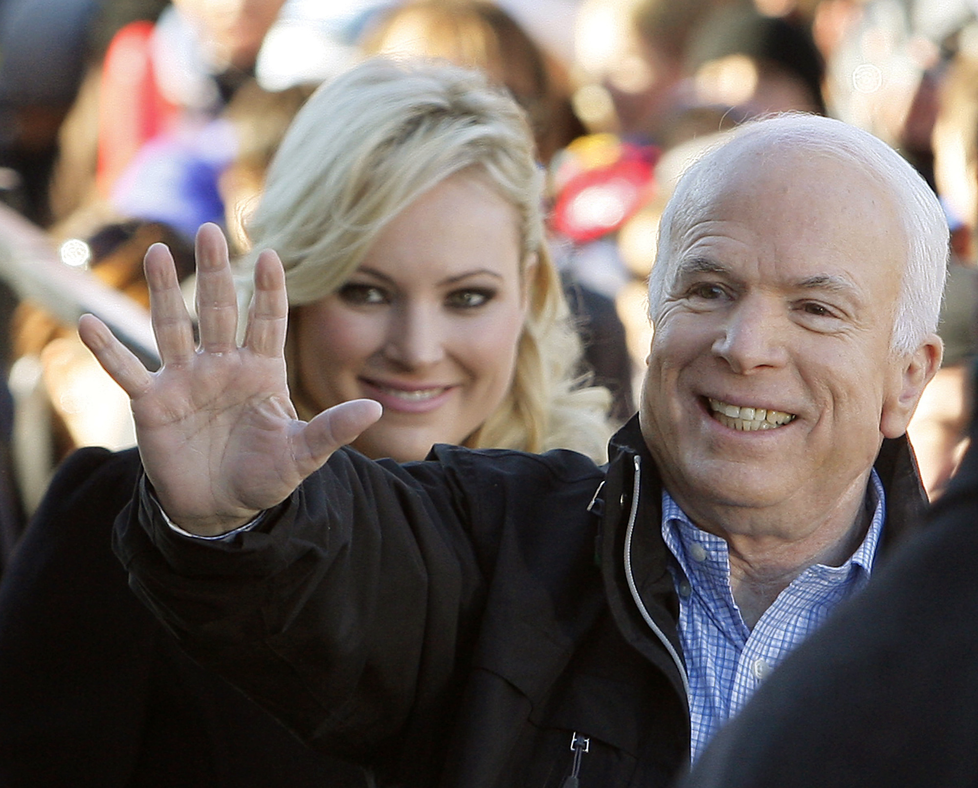 "FILE - In this Oct. 30, 20087 file photo, Republican presidential candidate Sen. John McCain, R-Ariz., accompanied by his daughter Meghan McCain, waves to supporters as he enters a campaign rally in Defiance, Ohio.  Former Vice President Joe Biden sought to console the daughter of ailing Sen. John McCain after she began crying while discussing her father's cancer on ABC's ""The View."" McCain is battling the same aggressive type of brain cancer that killed Biden's son Beau in 2015.  (AP Photo/Stephan Savoia)"
