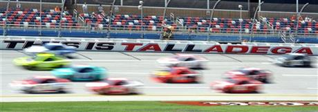 In this image taken with a slow shutter speed, drivers practice for Sunday's Aaron's 499 NASCAR auto race at Talladega Superspeedway on Friday, May 2, 2014, in Talladega, Ala.