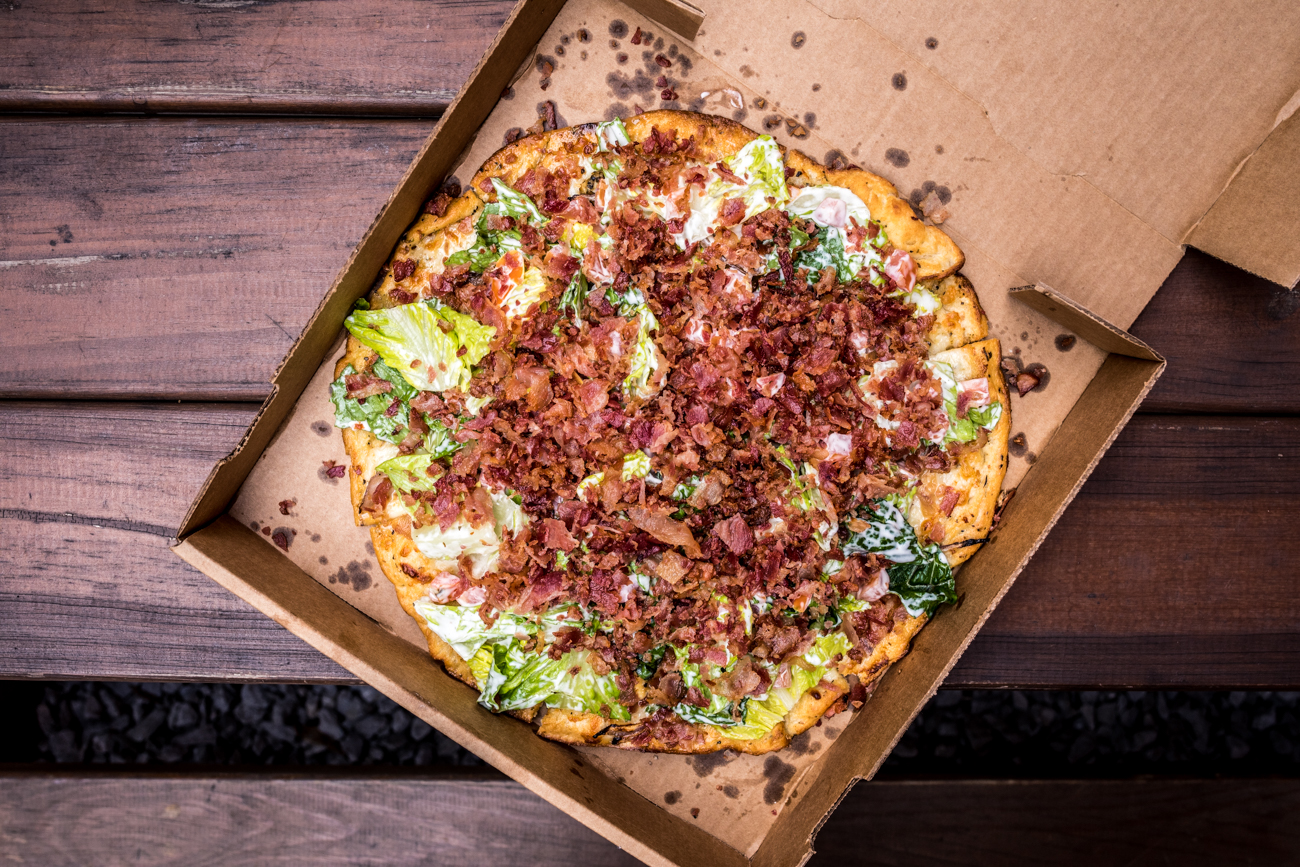 BLT Pizza: this award-winning pie is topped with bacon, lettuce, tomato, ranch, red onion, and chicken / Image: Catherine Viox // Published: 4.6.20