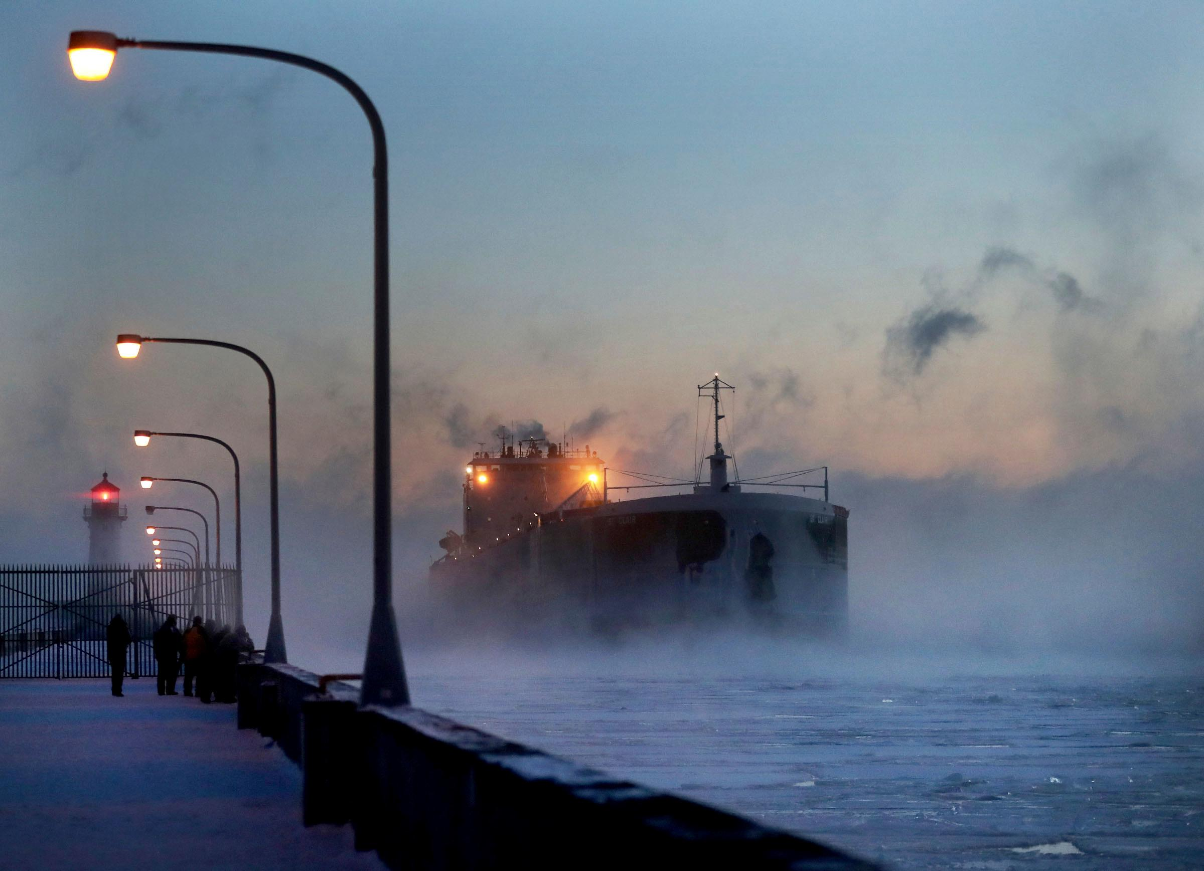 Steam rises from Lake Superior as the ship St. Clair comes to harbor during some of the coldest temps of the year, Sunday, Dec. 31, 2017, at Canal Park in Duluth, Minn. The St. Clair is a self-unloader built in 1976 at Sturgeon Bay, Wis., and is 770 feet long and has 26 hatches that open into 5 cargo holds, providing a load capacity of 45,000 tons. (David Joles/Star Tribune via AP)